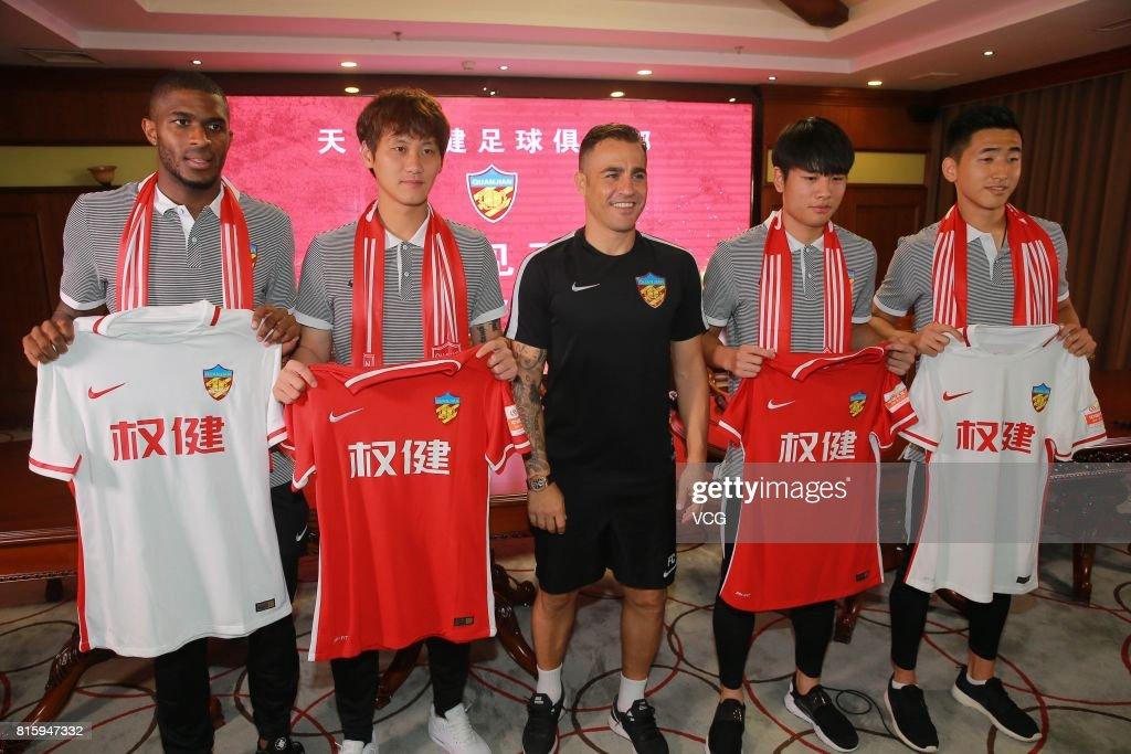 Anthony Modeste, Pei Shuai, Tianjin Quanjian manager Fabio Cannavaro, Zhang Yuan and Qian Yumiao pose at a press conference of Tianjin Quanjian FC on July 17, 2017 in Tianjin, China. Anthony Modeste plays for Tianjin Quanjian in the 2017 Chinese Super League (CSL) matches.