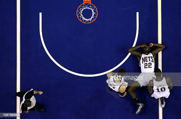 Anthony Morrow lies on the court after a fall during the NBA match between New Jersey Nets and the Toronto Raptors at the O2 Arena on March 4 2011 in...