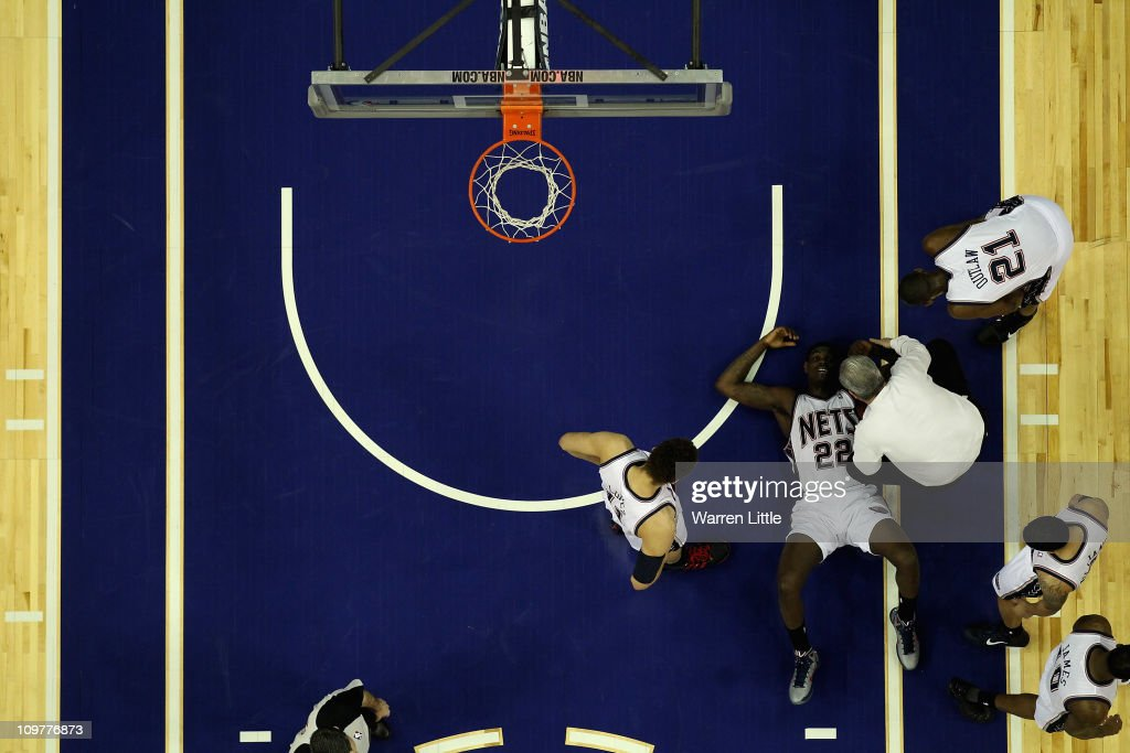 Anthony Morrow #22 lies on the court after a heavy fall during the NBA match between New Jersey Nets and the Toronto Raptors at the O2 Arena on March 4, 2011 in London, England.