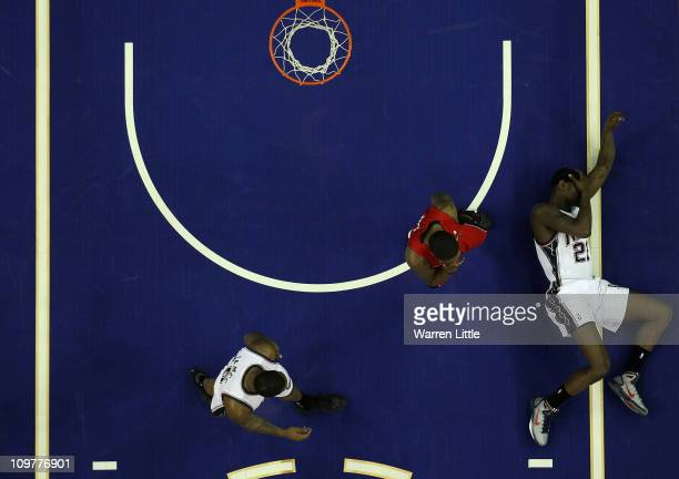 Anthony Morrow lies on the court after a heavy fall during the NBA match between New Jersey Nets and the Toronto Raptors at the O2 Arena on March 4...