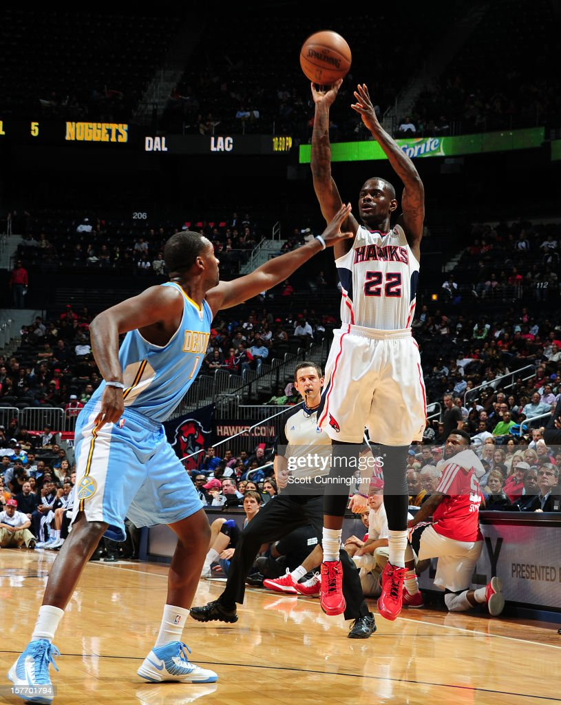 Anthony Morrow #22 of the Atlanta Hawks takes a shot against Jordan Hamilton #1 of the Denver Nuggets at Philips Arena on December 5, 2012 in Atlanta, Georgia.