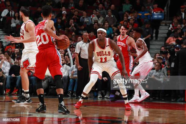 Anthony Morrow of the Chicago Bulls plays defense against Timothe LuwawuCabarrot of the Philadelphia 76ers on March 24 2017 at the United Center in...