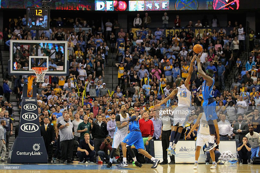 Anthony Morrow #23 of the Dallas Mavericks misses a shot in the final seconds against Corey Brewer #13 of the Denver Nuggets at the Pepsi Center on April 4, 2013 in Denver, Colorado. The Nuggets defeated the Mavericks 95-94.