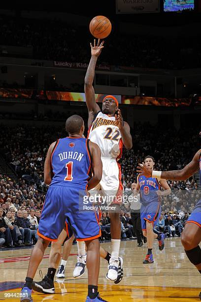 Anthony Morrow of the Golden State Warriors shoots over Chris Duhon of the New York Knicks during the game at Oracle Arena on April 2 2010 in Oakland...