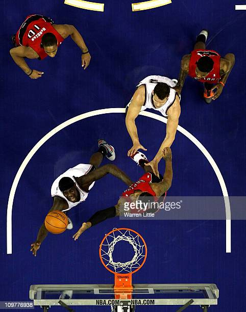 Anthony Morrow of the Nets jumps against James Johnson of the Raptors during the NBA match between New Jersey Nets and the Toronto Raptors at the O2...