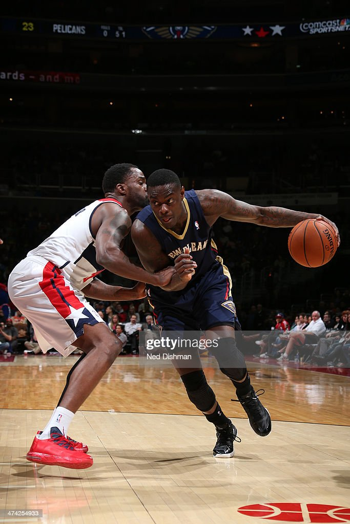 <a gi-track='captionPersonalityLinkClicked' href=/galleries/search?phrase=Anthony+Morrow&family=editorial&specificpeople=814354 ng-click='$event.stopPropagation()'>Anthony Morrow</a> #3 of the New Orleans Pelicans drives against Martell Webster #9 of the Washington Wizards during the game at the Verizon Center on February 22, 2014 in Washington, DC.