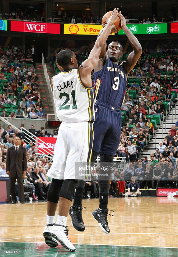 Anthony Morrow #3 of the New Orleans Pelicans shoots against Ian Clark #21 of the Utah Jazz at EnergySolutions Arena on April 04, 2014 in Salt Lake City, Utah.