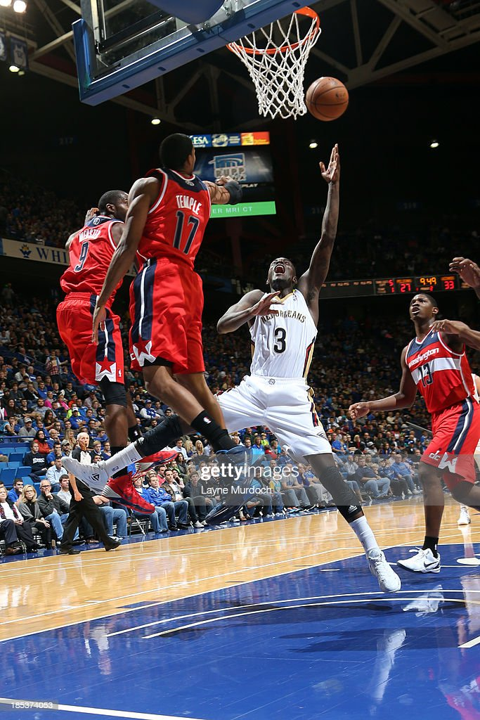 <a gi-track='captionPersonalityLinkClicked' href=/galleries/search?phrase=Anthony+Morrow&family=editorial&specificpeople=814354 ng-click='$event.stopPropagation()'>Anthony Morrow</a> #3 of the New Orleans Pelicans shoots between <a gi-track='captionPersonalityLinkClicked' href=/galleries/search?phrase=Martell+Webster&family=editorial&specificpeople=601785 ng-click='$event.stopPropagation()'>Martell Webster</a> #9, <a gi-track='captionPersonalityLinkClicked' href=/galleries/search?phrase=Garrett+Temple&family=editorial&specificpeople=709398 ng-click='$event.stopPropagation()'>Garrett Temple</a> #17 and <a gi-track='captionPersonalityLinkClicked' href=/galleries/search?phrase=Kevin+Seraphin&family=editorial&specificpeople=6474998 ng-click='$event.stopPropagation()'>Kevin Seraphin</a> #13 of the Washington Wizards during an NBA game on October 19, 2013 at Rupp Arena in Lexington, Kentucky.