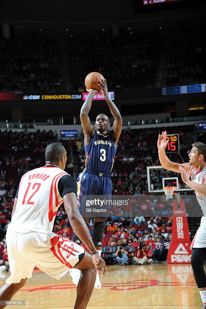 Anthony Morrow #3 of the New Orleans Pelicans shoots the ball against Dwight Howard #12 of the Houston Rockets the 2013 NBA pre-season game on October 5, 2013 at the Toyota Center in Houston, Texas.