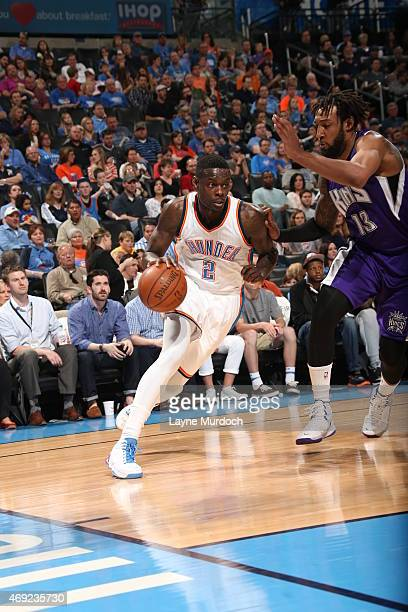 Anthony Morrow of the Oklahoma City Thunder drives to the basket against Derrick Williams of the Sacramento Kings on April 10 2015 at the Chesapeake...