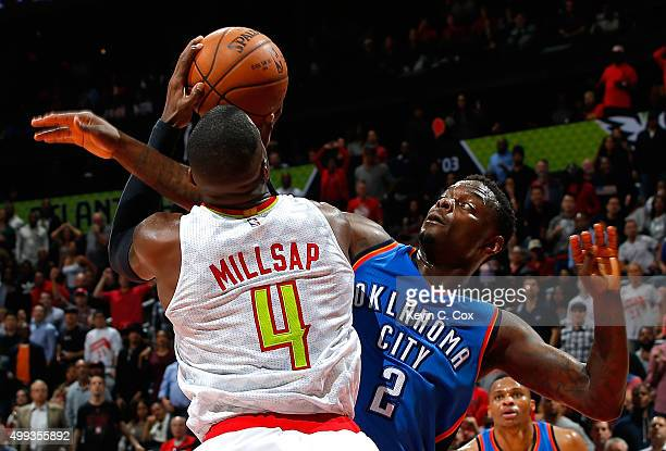 Anthony Morrow of the Oklahoma City Thunder fouls Paul Millsap of the Atlanta Hawks at Philips Arena on November 30 2015 in Atlanta Georgia NOTE TO...