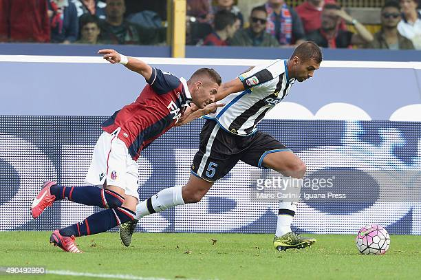 Anthony Mounier of Bologna FC competes the ball with Danilo Larangeira of Udinese Calcio during the Serie A match between Bologna FC and Udinese...