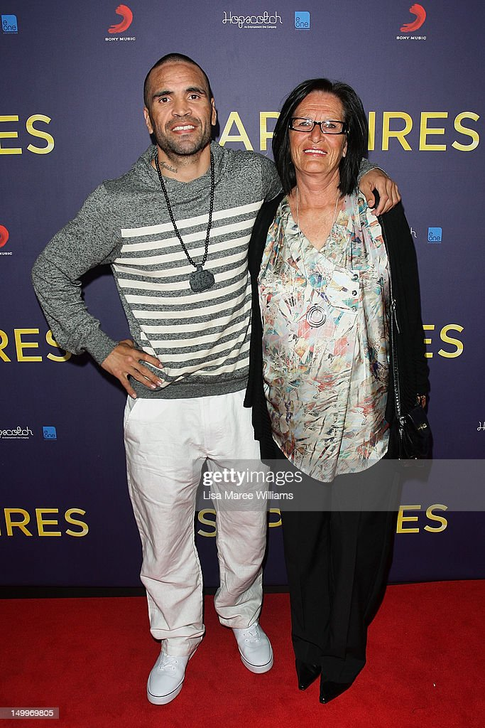 Anthony Mundine and his mother Lyn Mundine pose on the red carpet at the Sydney Premiere of The Sapphires at State Theatre on August 8, 2012 in Sydney, Australia.
