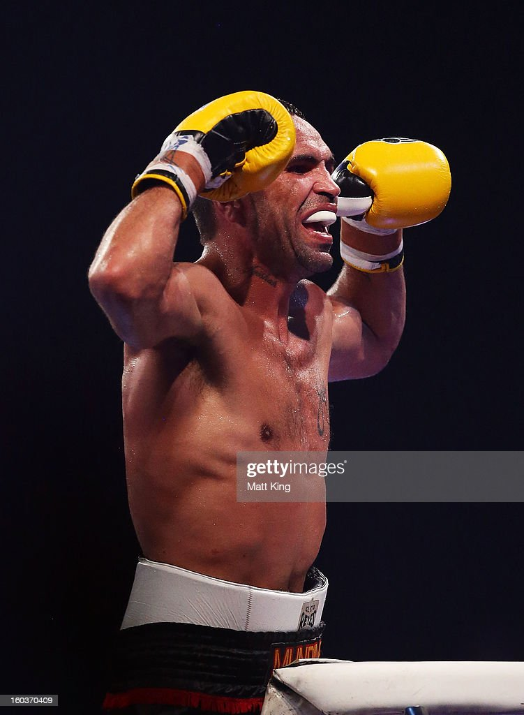 Anthony Mundine gestures towards the crowd after the IBF Middleweight Title bout between Anthony Mundine and Daniel Geale at Sydney Entertainment Centre on January 30, 2013 in Sydney, Australia.