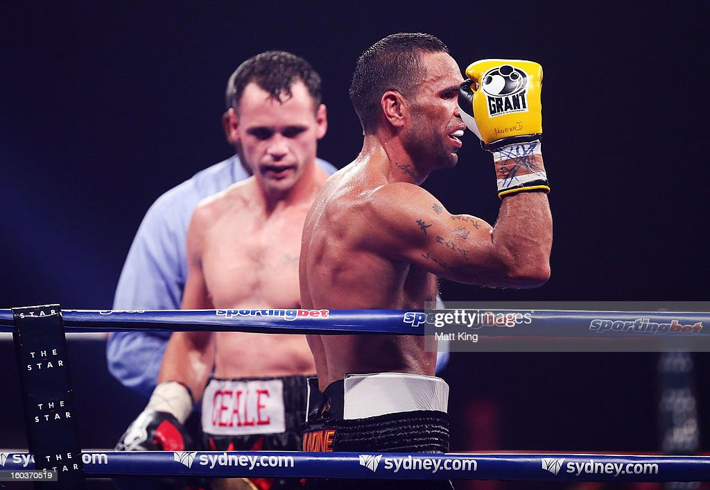 Anthony Mundine (R) gestures towards the crowd as Daniel Geale looks on after the IBF Middleweight Title bout between Anthony Mundine and Daniel Geale at Sydney Entertainment Centre on January 30, 2013 in Sydney, Australia.