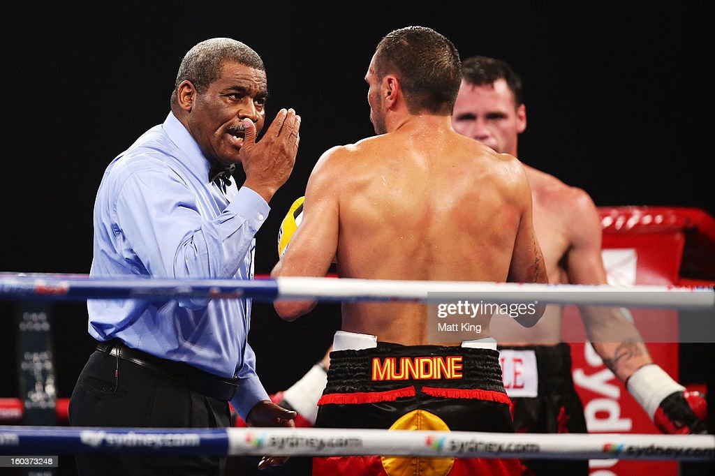 Anthony Mundine is given a warning for using his head during the IBF Middleweight Title bout between Anthony Mundine and Daniel Geale at Sydney Entertainment Centre on January 30, 2013 in Sydney, Australia.
