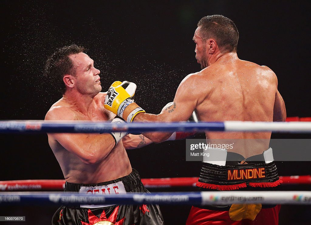 <a gi-track='captionPersonalityLinkClicked' href=/galleries/search?phrase=Anthony+Mundine&family=editorial&specificpeople=213446 ng-click='$event.stopPropagation()'>Anthony Mundine</a> (R) lands a left on <a gi-track='captionPersonalityLinkClicked' href=/galleries/search?phrase=Daniel+Geale&family=editorial&specificpeople=2229560 ng-click='$event.stopPropagation()'>Daniel Geale</a> (L) during the IBF Middleweight Title bout between <a gi-track='captionPersonalityLinkClicked' href=/galleries/search?phrase=Anthony+Mundine&family=editorial&specificpeople=213446 ng-click='$event.stopPropagation()'>Anthony Mundine</a> and <a gi-track='captionPersonalityLinkClicked' href=/galleries/search?phrase=Daniel+Geale&family=editorial&specificpeople=2229560 ng-click='$event.stopPropagation()'>Daniel Geale</a> at Sydney Entertainment Centre on January 30, 2013 in Sydney, Australia.