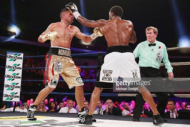 Anthony Mundine of Australia is hit by Charles Hatley of the USA during their bout at The Melbourne Convention and Exhibition Centre on November 11...