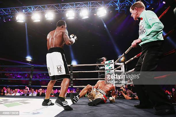 Anthony Mundine of Australia is knocked down by Charles Hatley of the USA at The Melbourne Convention and Exhibition Centre on November 11 2015 in...