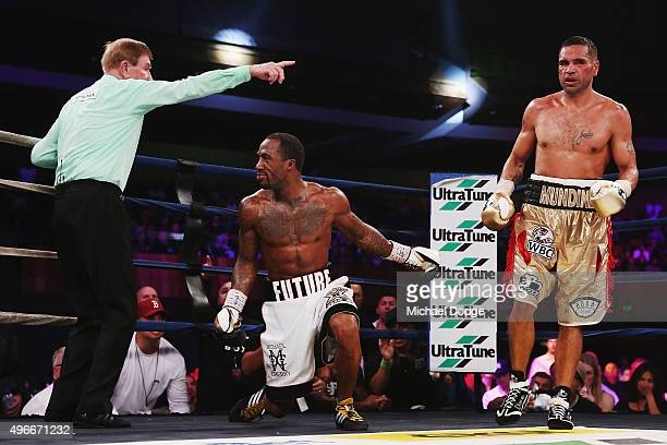 Anthony Mundine of Australia knocks down Charles Hatley of the USA during their bout at The Melbourne Convention and Exhibition Centre on November 11...