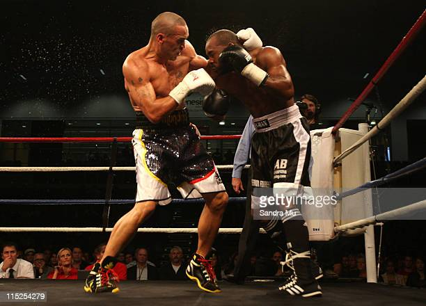 Anthony Mundine of Australia punches Xavier Toliver of America during the Clash for Canterbury Fight Night at Trusts Stadium on June 5 2011 in...