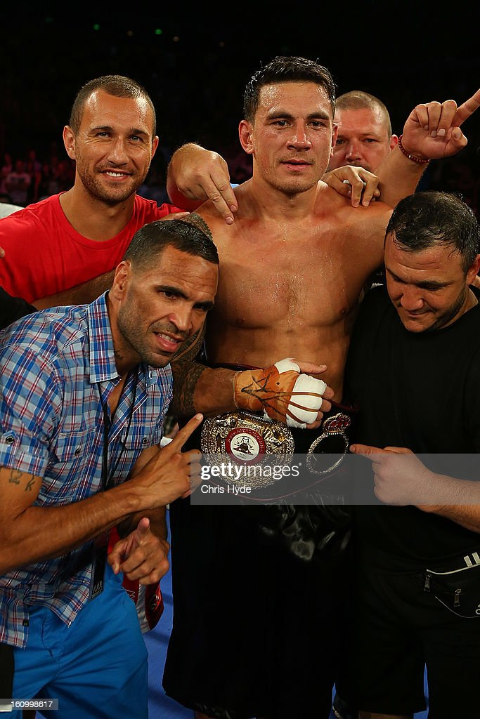 <a gi-track='captionPersonalityLinkClicked' href=/galleries/search?phrase=Anthony+Mundine&family=editorial&specificpeople=213446 ng-click='$event.stopPropagation()'>Anthony Mundine</a>, <a gi-track='captionPersonalityLinkClicked' href=/galleries/search?phrase=Sonny+Bill+Williams&family=editorial&specificpeople=204424 ng-click='$event.stopPropagation()'>Sonny Bill Williams</a> and <a gi-track='captionPersonalityLinkClicked' href=/galleries/search?phrase=Quade+Cooper&family=editorial&specificpeople=4176008 ng-click='$event.stopPropagation()'>Quade Cooper</a> celebrate after <a gi-track='captionPersonalityLinkClicked' href=/galleries/search?phrase=Sonny+Bill+Williams&family=editorial&specificpeople=204424 ng-click='$event.stopPropagation()'>Sonny Bill Williams</a> heavyweight bout win against Francois Botha at the Brisbane Entertainment Centre on February 8, 2013 in Brisbane, Australia.