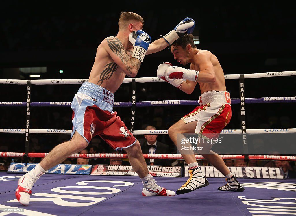 Anthony Nelson (claret and blue shorts) and Jamie Conlan (red and white shorts) during the Commonwealth Super Flyweight Championship contest between Anthony Nelson and Jamie Conlan at Copper Box Arena on April 30, 2016 in London, England.