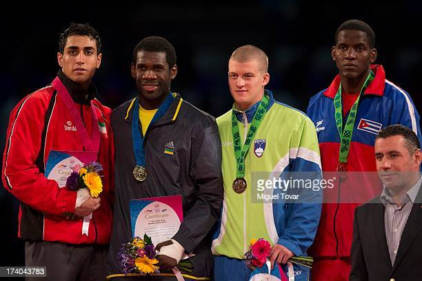 Anthony Obame of Gabon receives the gold medal of men's 87 kg combat of WTF World Taekwondo Championships 2013 at the exhibitions Center on July 19...