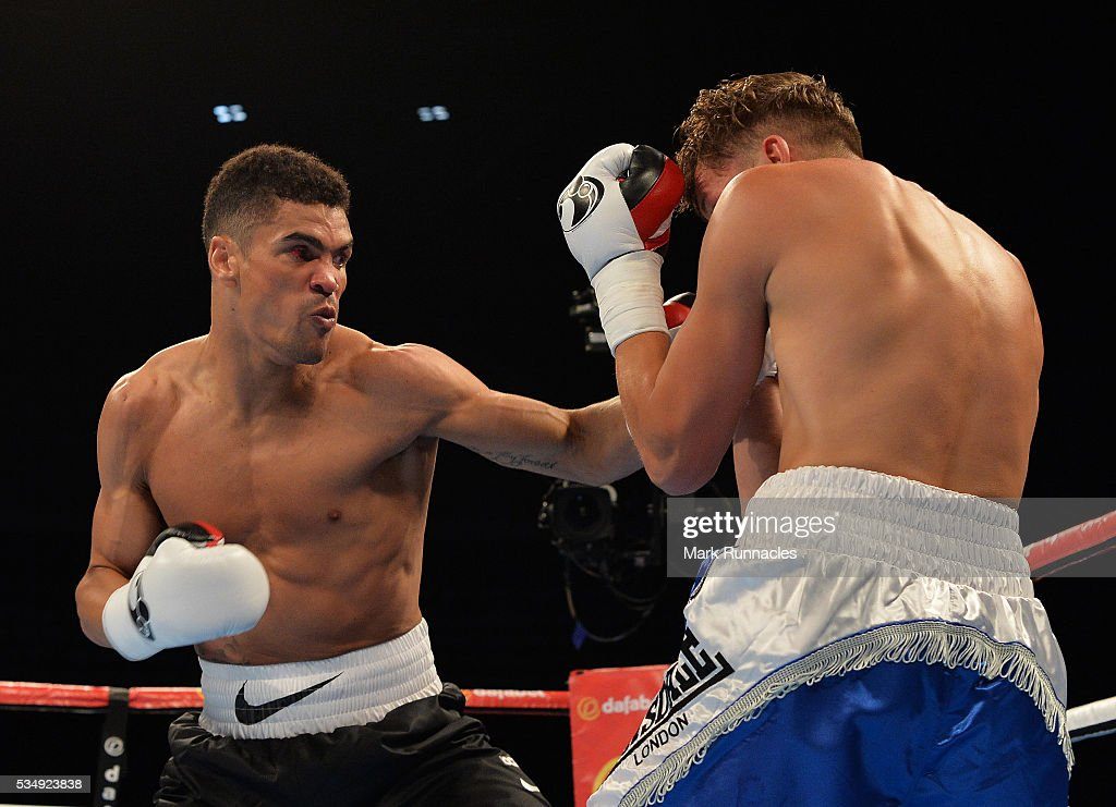 <a gi-track='captionPersonalityLinkClicked' href=/galleries/search?phrase=Anthony+Ogogo&family=editorial&specificpeople=2120871 ng-click='$event.stopPropagation()'>Anthony Ogogo</a> (Black and White Shorts), and <a gi-track='captionPersonalityLinkClicked' href=/galleries/search?phrase=Gary+Cooper&family=editorial&specificpeople=93434 ng-click='$event.stopPropagation()'>Gary Cooper</a> (Blue and White Shorts), during an undercard bout ahead of the WBA world super-lightweight title fight between Ricky Burns and Michele Di Rocco at The SSE Hydro on May 28, 2016 in Glasgow, Scotland.