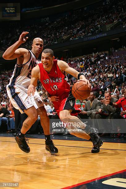 Anthony Parker of the Toronto Raptors drives to the basket around against Richard Jefferson of the New Jersey Nets in Game Six of the Eastern...