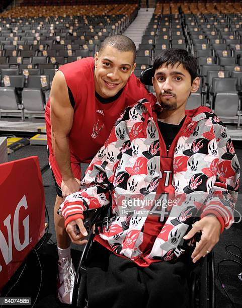 Anthony Parker of the Toronto Raptors poses with a fan from the MakeAWish Foundation prior to a game against the Dallas Mavericks at the Air Canada...