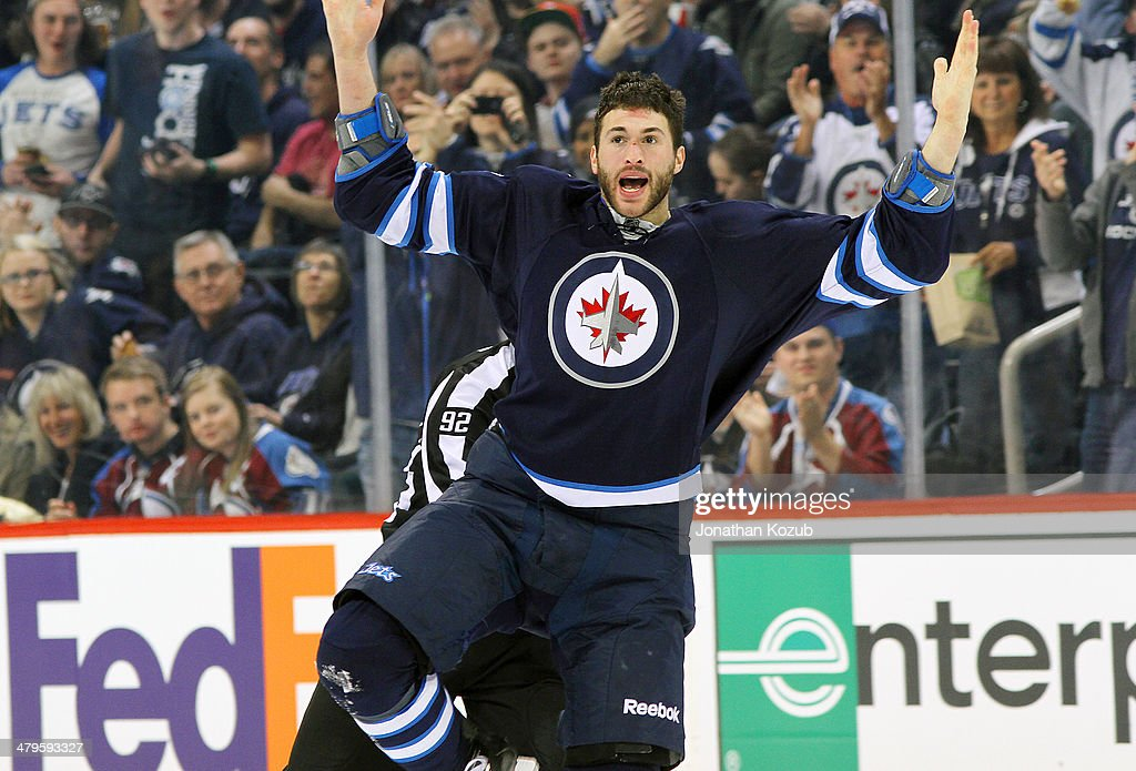 Anthony Peluso #14 of the Winnipeg Jets throws his arms in the air to pump up the fans after a second period fight against Patrick Bordeleau #58 of the Colorado Avalanche (not shown) at the MTS Centre on March 19, 2014 in Winnipeg, Manitoba, Canada.