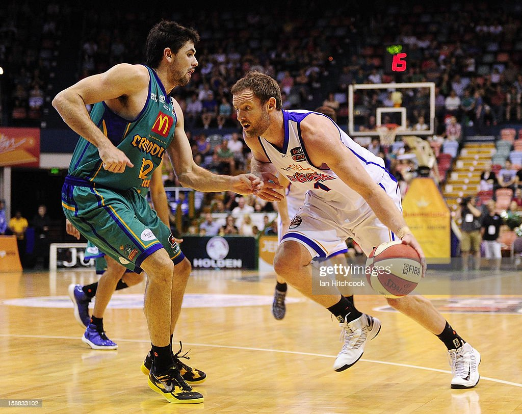 Anthony Petrie of the 36ers drives to the basket past Todd Blanchfield of the Crocodiles during the round 12 NBL match between the Townsville Crocodiles and the Adelaide 36ers at Townsville Entertainment Centre on December 31, 2012 in Townsville, Australia.