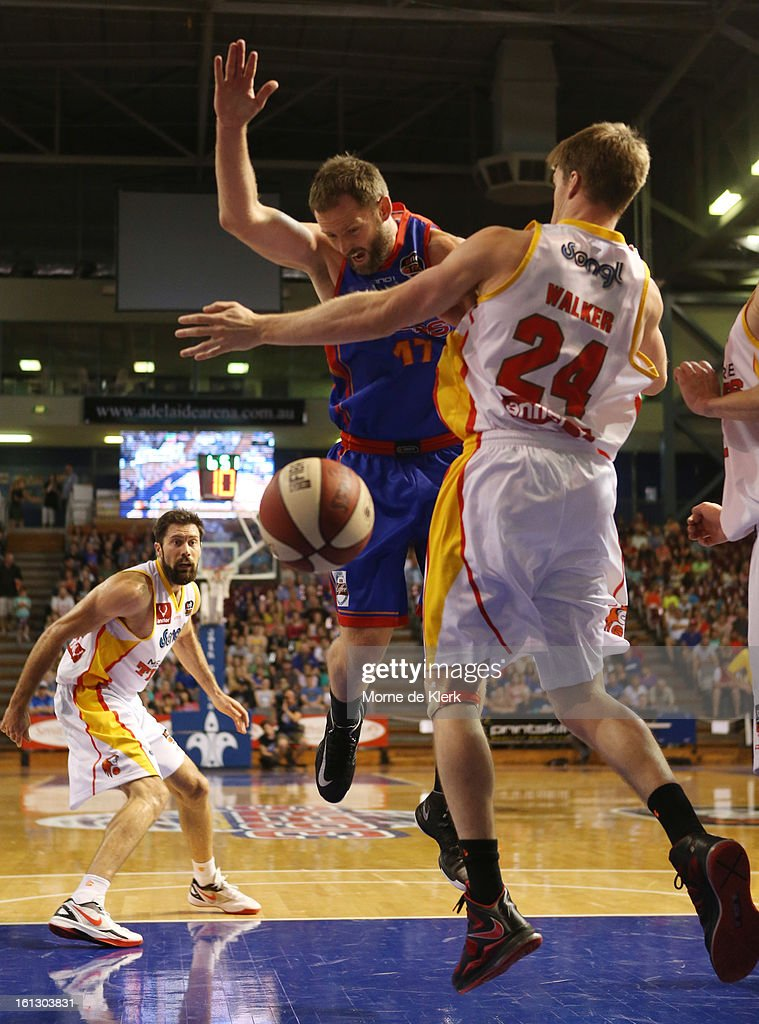 Anthony Petrie of the 36ers is blocked by Lucas Walker of the Tigers during the round 18 NBL match between the Adelaide 36ers and the Melbourne Tigers at Adelaide Arena on February 10, 2013 in Adelaide, Australia.
