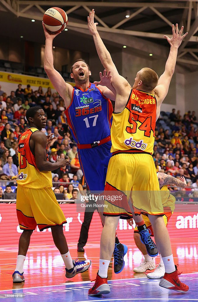 Anthony Petrie of the 36ers shoots over the top of Adam Ballinger of the Tigers during the round three NBL match between the Melbourne Tigers and the Adelaide 36ers at the State Netball Hockey Centre in October 27, 2013 in Melbourne, Australia.