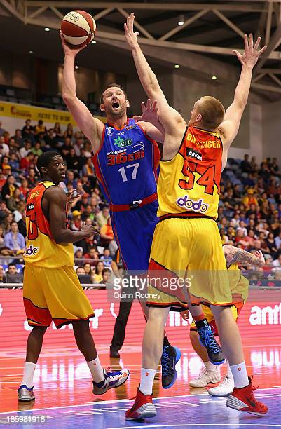 Anthony Petrie of the 36ers shoots over the top of Adam Ballinger of the Tigers during the round three NBL match between the Melbourne Tigers and the...