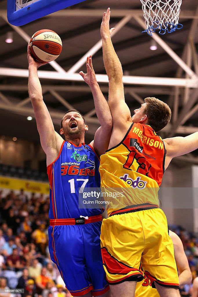 Anthony Petrie of the 36ers shoots over the top of Scott Morrison of the Tigers during the round three NBL match between the Melbourne Tigers and the Adelaide 36ers at the State Netball Hockey Centre in October 27, 2013 in Melbourne, Australia.
