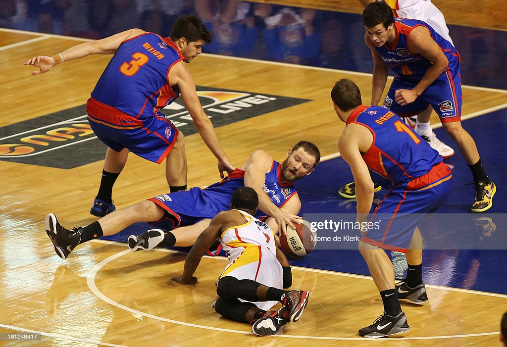 Anthony Petrie of the 36ers wins the ball on the ground during the round 18 NBL match between the Adelaide 36ers and the Melbourne Tigers at Adelaide Arena on February 10, 2013 in Adelaide, Australia.