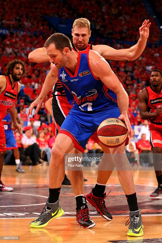 Anthony Petrie of the 36ers works into the key way against Shawn Redhage of the Wildcats during game one of the NBL Grand Final series between the Perth Wildcats and the Adelaide 36ers at Perth Arena on April 7, 2014 in Perth, Australia.