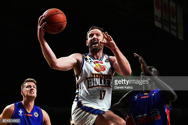 Anthony Petrie of the Brisbane Bullets makes a shot on basket over Majok Deng of the Adelaide 36ers during the round seven NBL match between the...