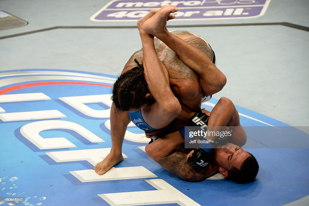 Anthony Pettis attempts to submit Benson Henderson in their UFC lightweight championship bout at BMO Harris Bradley Center on August 31 2013 in...