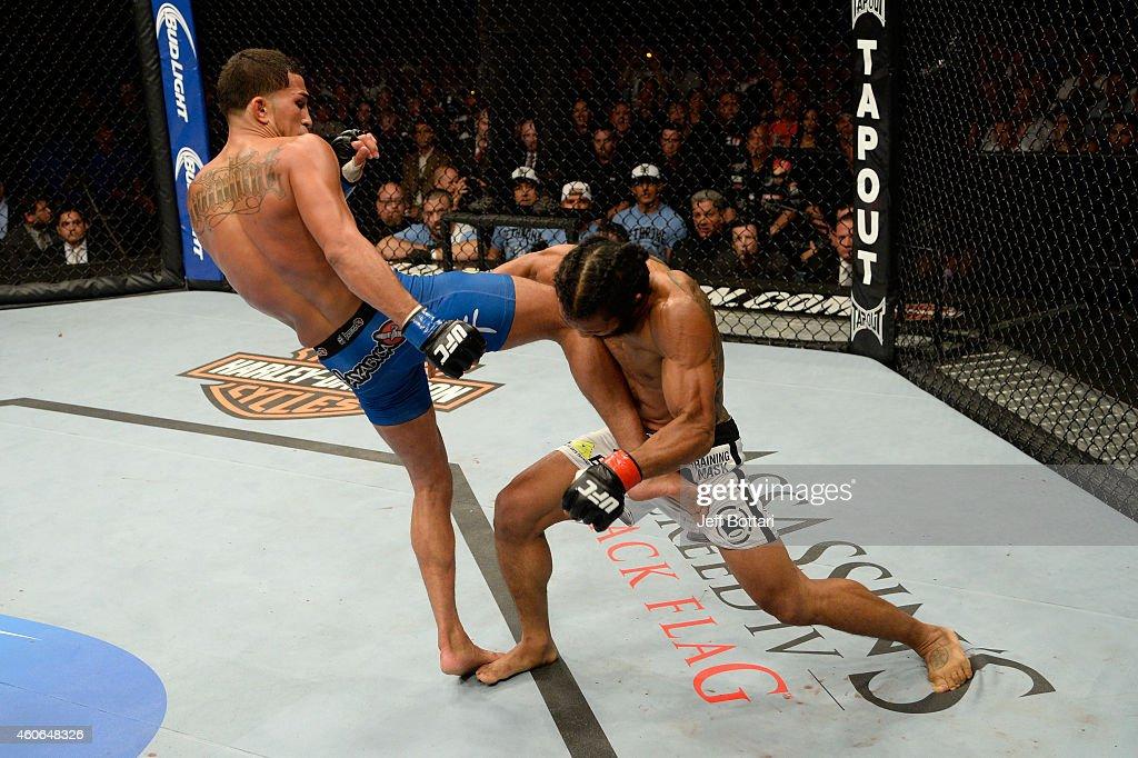 Anthony Pettis kicks Benson Henderson in their UFC lightweight championship bout at BMO Harris Bradley Center on August 31 2013 in Milwaukee Wisconsin