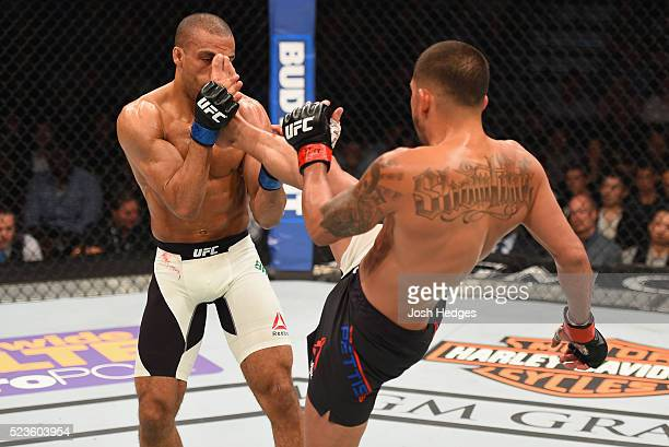 Anthony Pettis kicks Edson Barboza in their lightweight bout during the UFC 197 event inside MGM Grand Garden Arena on April 23 2016 in Las Vegas...