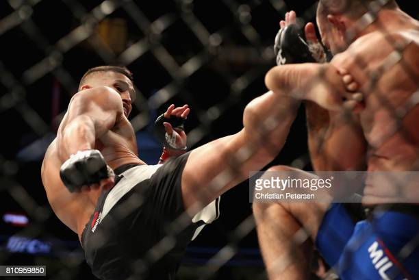 Anthony Pettis kicks Jim Miller in their lightweight bout during the UFC 213 event at TMobile Arena on July 8 2017 in Las Vegas Nevada