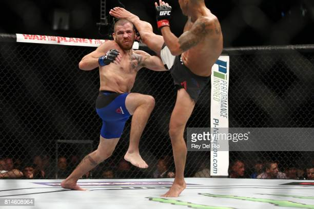 Anthony Pettis kicks Jim Miller in their lightweight bout during the UFC 213 event at TMobile Arena on July 9 2017 in Las Vegas Nevada