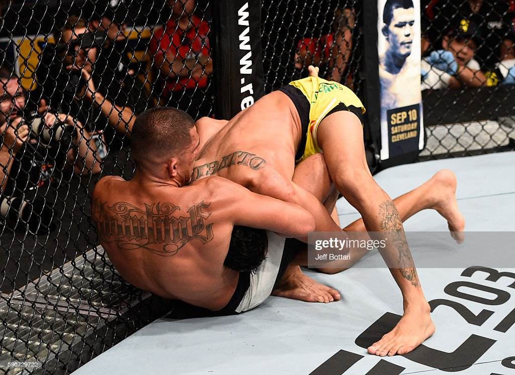 Anthony Pettis of the United States attempts to submit Charles Oliveira of Brazil in their featherweight bout during the UFC Fight Night event at...