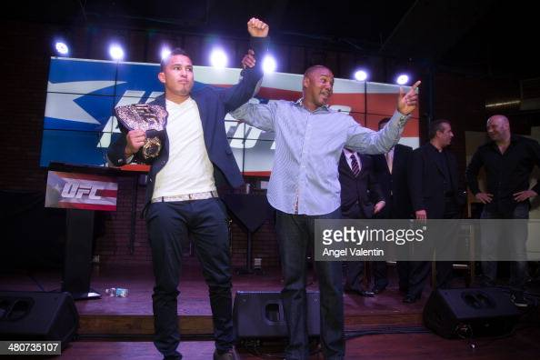 Anthony Pettis UFC lightweight champion and Felix Tito Trinidad former boxing champion attend a UFC press conference on March 26 2014 in San Juan...