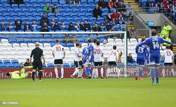 Anthony Pilkington of Cardiff City scores his sides first goal of the match after his shot deflects off the wall sending goalkeeper Marcus Bettinelli...
