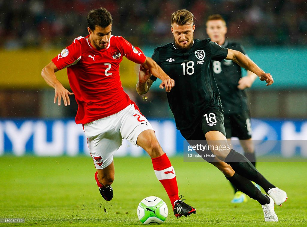 Anthony Pilkington of Ireland (R) challenges Gyoergy Garics of Austria during the FIFA World Cup 2014 Group C qualification match between Austria and the Republic of Ireland at the Ernst Happel Stadium on September 10, 2013 in Vienna, Austria.