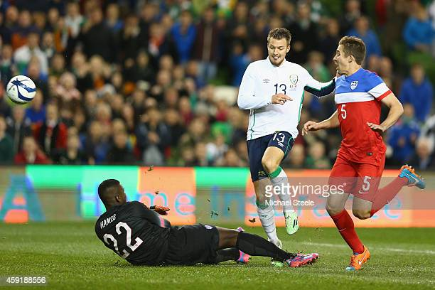 Anthony Pilkington of Ireland lobs the ball over goalkeeper Bill Hamid of USA to score his sides opening goal during the International Friendly match...